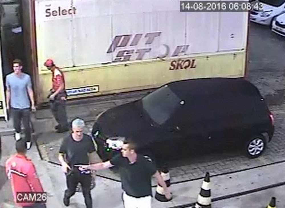 In this Sunday, Aug. 14, 2016 frame from surveillance video released by Brazil Police, swimmer Ryan Lochte, second from right, of the United States, and teammates, appear at a gas station during the 2016 Summer Olympics in Rio de Janeiro, Brazil. (Brazil Police via AP)