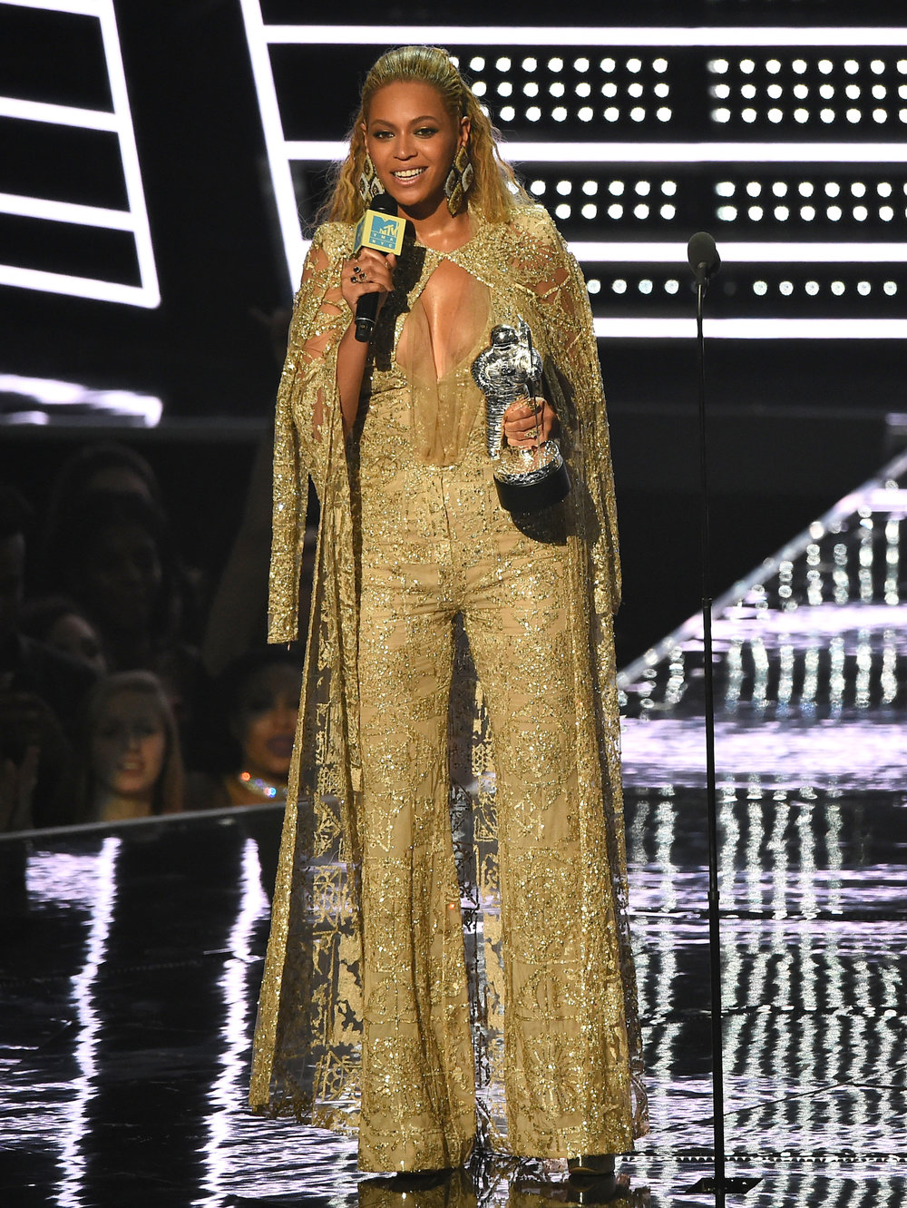 """Beyonce accepts the award for best female video for """"Hold Up"""" at the MTV Video Music Awards at Madison Square Garden on Sunday, Aug. 28, 2016, in New York. (Charles Sykes/Invision/AP)"""