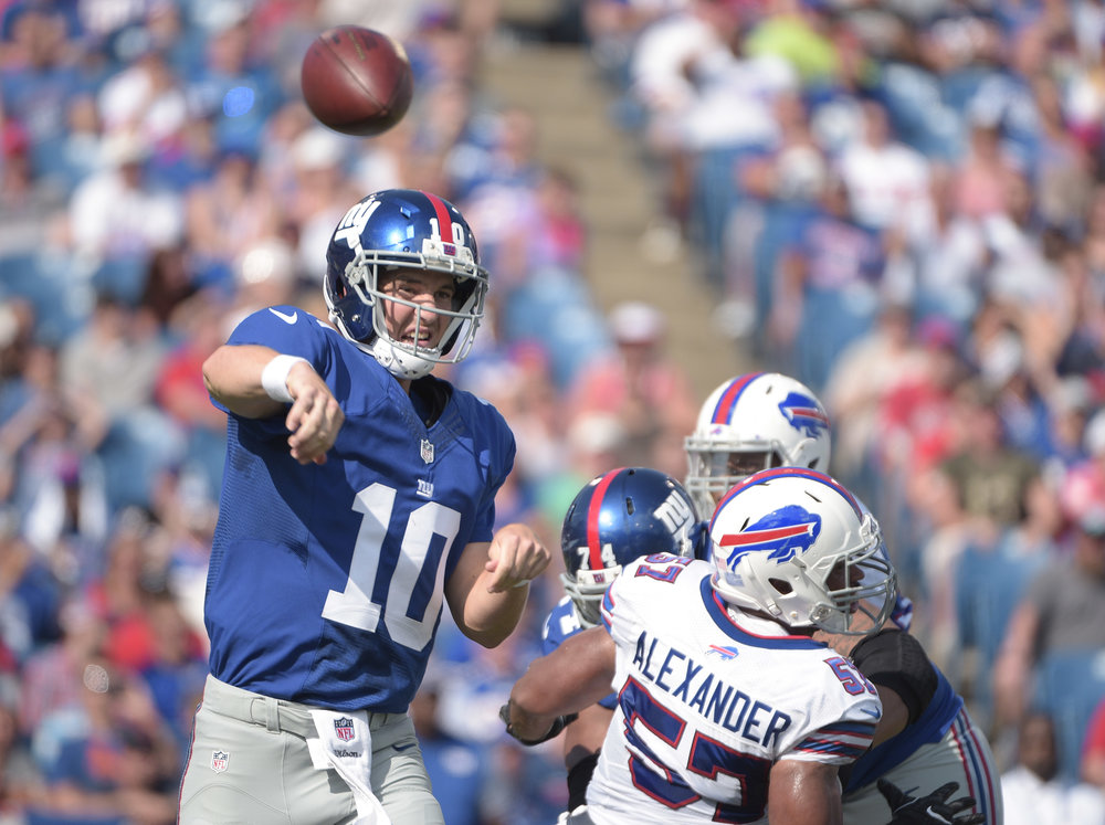 New York Giants quarterback Eli Manning (10) passes against the Buffalo Bills during the first quarter of a preseason NFL football game, Saturday, Aug. 20, 2016, in Buffalo, N.Y. (Gary Wiepert/AP)