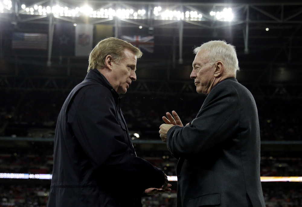 In this Nov. 9, 2014, file photo, NFL commissioner Roger Goodell, left, and Dallas Cowboys owner Jerry Jones talk during an NFL football game between the Jacksonville Jaguars and Dallas Cowboys at Wembley Stadium in London. (Matt Dunham/AP)