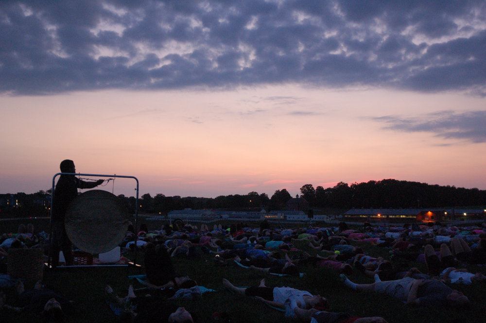 Students relax during sunset yoga on Horsebarn Hill on Sept. 4, 2015 (Erika Elechicon/The Daily Campus)