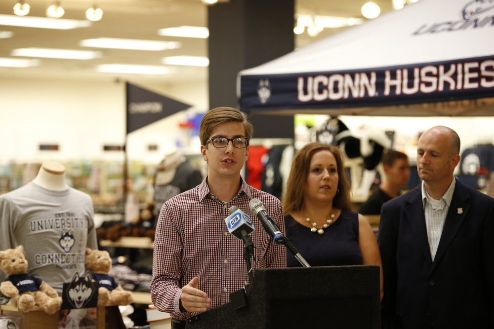 Undergraduate Student Government President Dan Byrd speaks at the UConn Bookstore press conference regarding open source textbooks on Tues., Sept. 6. State Representative Gregg Haddad (D-Mansfield) and Senator Mae Flexer (D- Killingly) were in attendance. (Tyler Benton/The Daily Campus)