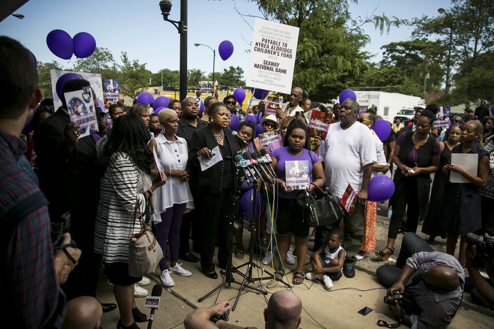 Family members and supporters gather for a vigil for Nykea Aldridge at the Willie Mae Morris Empowerment Center, Sunday afternoon, Aug. 28, 2016, in Chicago. (Ashlee Rezin/Chicago Sun-Times via AP)