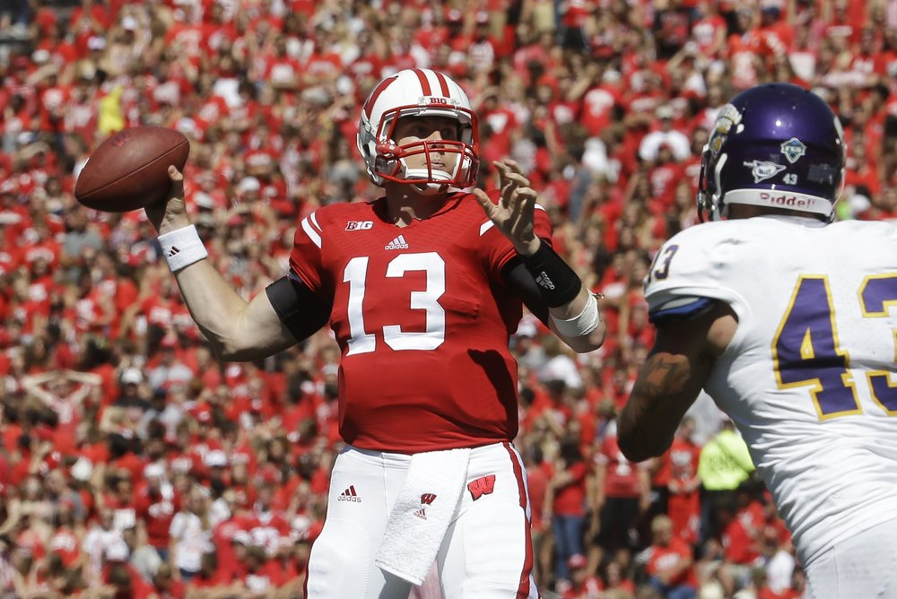 In this Sept. 6, 2014, file photo, Wisconsin quarterback Bart Houston throws during the second half of an NCAA college football game against Western Illinois in Madison, Wis. (AP Photo/Morry Gash, File)