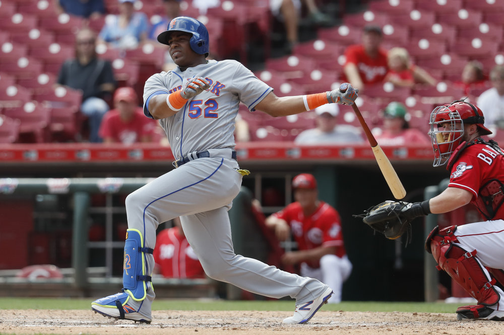 New York Mets' Yoenis Cespedes hits an RBI double off Cincinnati Reds relief pitcher Tony Cingrani in the ninth inning of a baseball game, Wednesday, Sept. 7, 2016, in Cincinnati. The Mets won 6-3. (AP Photo/John Minchillo)