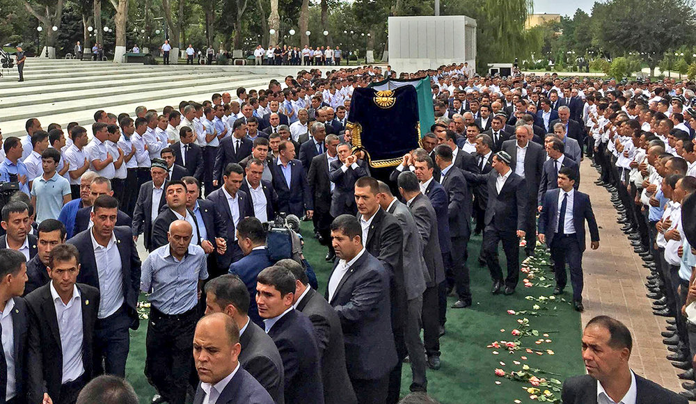 People line up as a coffin with the body of Uzbek President Islam Karimov is carried on during his funeral ceremony in Samarkand, Uzbekistan, Saturday, Sept. 3, 2016. (Kyrgyz Government Press Service Pool Photo/AP)