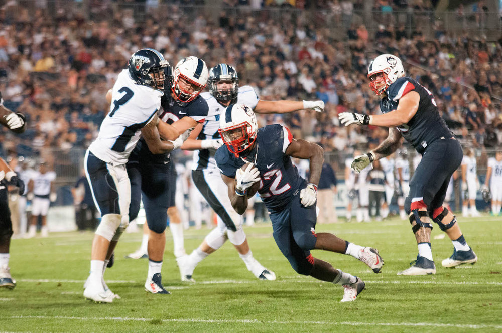 Arkeel Newsmen runs the ball during UConn's win against Maine, Sep. 1st, 2016. (Jackson Haigis/The Daily Campus)