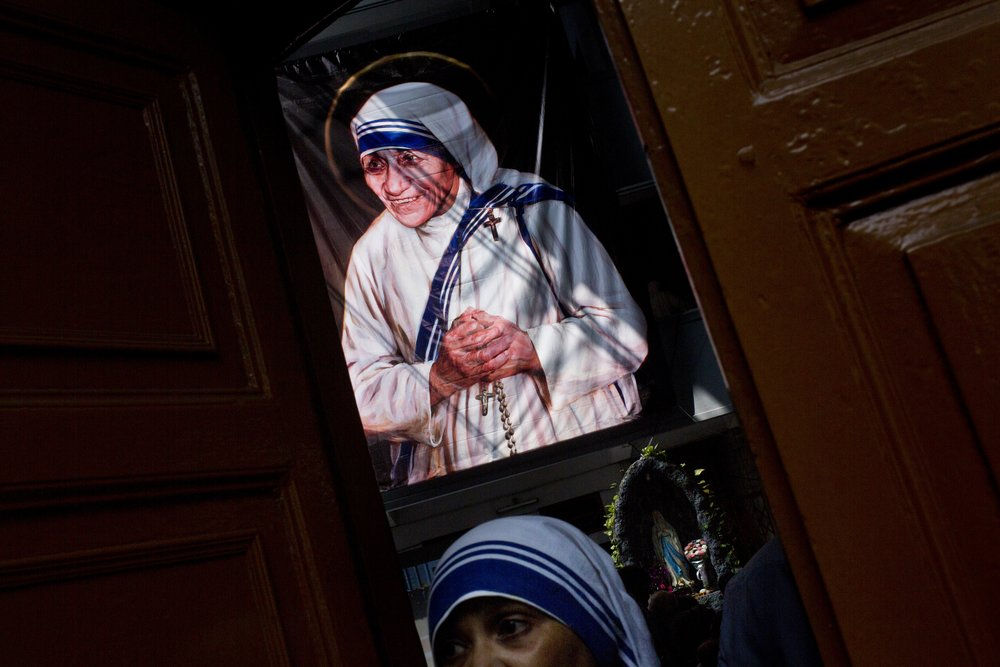 A giant picture of Mother Teresa is seen inside the Mother House, the Missionaries of Charity headquarters, in Kolkata, India, Sunday, Sept. 4, 2016. Francis has declared Mother Teresa a saint, honoring the tiny nun who cared for the world's most destitute as an icon for a Catholic Church that goes to the peripheries to find poor, wounded souls. (AP Photo/Bernat Armangue)
