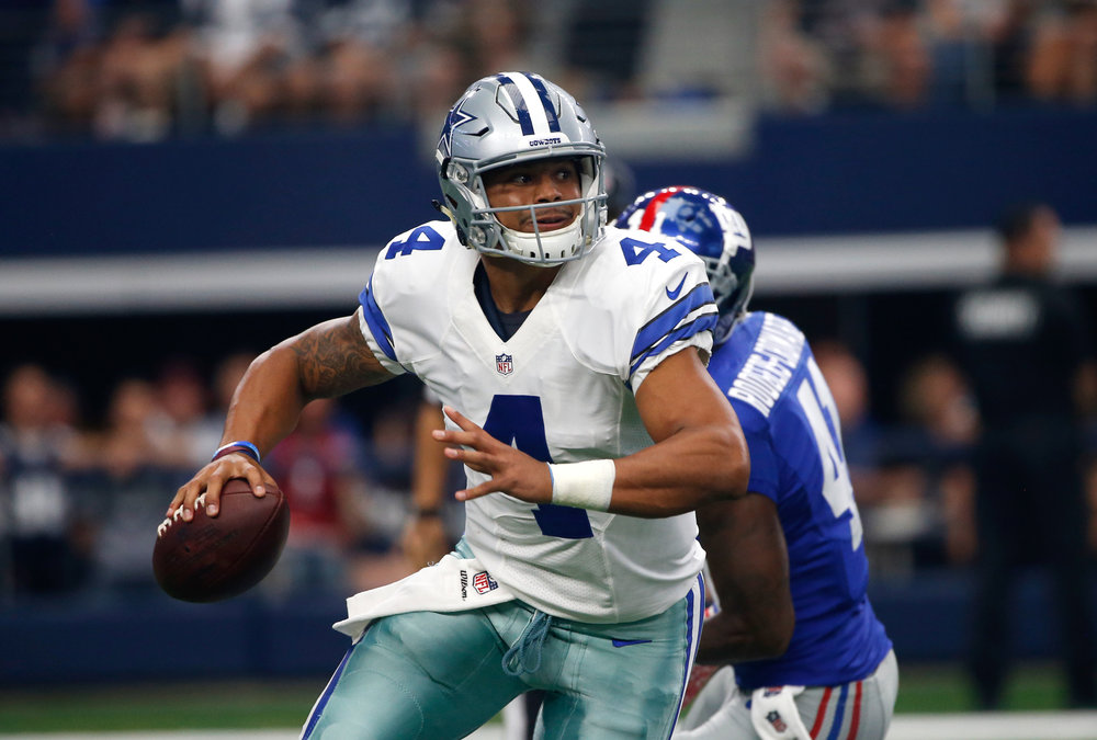 Dallas Cowboys quarterback Dak Prescott (4) scrambles out of the pocket under pressure from New York Giants' Dominique Rodgers-Cromartie (41) in the first half of an NFL football game, Sunday Sept. 11, 2016, in Arlington, Texas. (Ron Jenkins/AP)