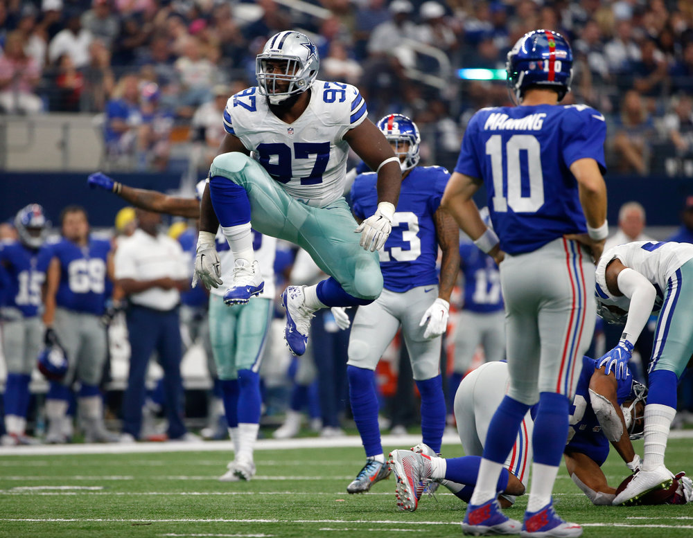 Dallas Cowboys defensive tackle Terrell McClain (97) celebrates tackling New York Giants running back Rashad Jennings as Eli Manning (10) watches in the second half of an NFL football game, Sunday Sept. 11, 2016, in Arlington, Texas. (Ron Jenkins/AP)