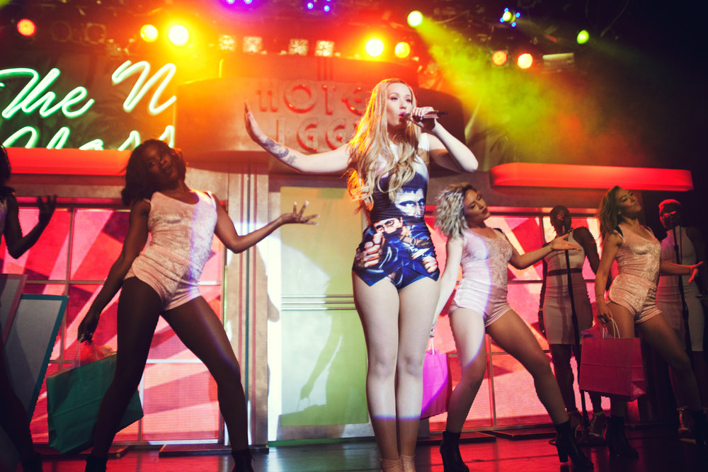 Iggy Azalea, center, has been criticized as a representation of white society's tendency to profit off black art forms. (Courtesy/Wikimedia Commons)