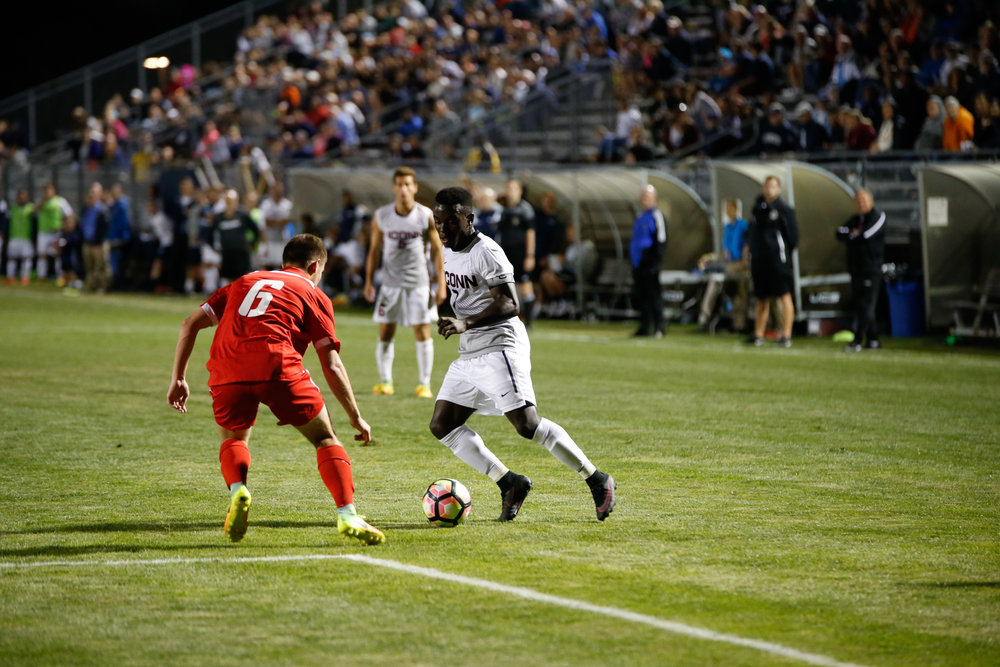 Senior captain Kwame Awuah attempts to dribble past a defender during the Huskies 2-0 victory over Cornell on Sept. 5, 2016 at Morrone Stadium. (Tyler Benton/The Daily Campus)