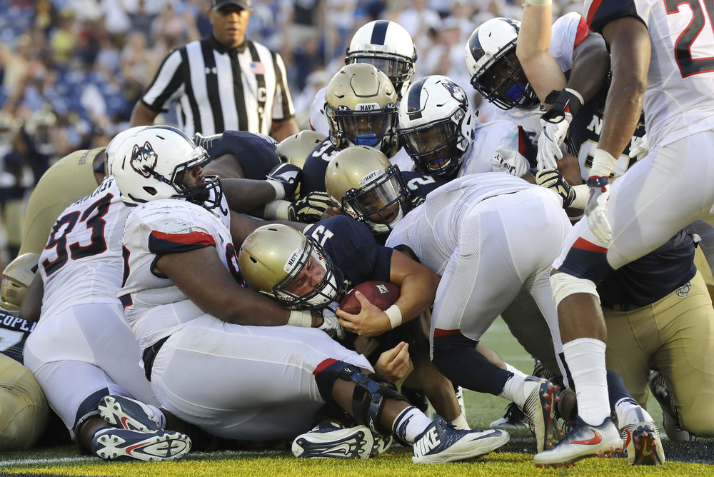 Navy quarterback Will Worth, center, falls into the end zone for a touchdown in the second half of an NCAA college football game against Connecticut in Annapolis, Md., Saturday, Sept. 10, 2016. Navy won 28-24. (Patrick Semansky/AP)