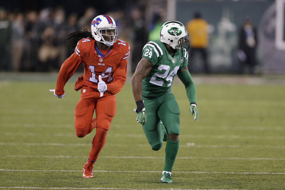 "In this Nov. 12, 2015, file photo, Buffalo Bills wide receiver Sammy Watkins, left, is defended by New York Jets cornerback Darrelle Revis during the first half of an NFL football game, in East Rutherford, N.J. The NFL isn't colorblind to the concerns of its TV audience regarding the ""Color Rush"" alternate uniforms the Bills and Jets will wear Thursday night, Sept. 14, 2016. That's a switch from last year, when Buffalo wore all red and the Jets all green during their prime-time game on Nov. 12. The combinations led to colorblind viewers complaining they couldn't determine which team was which. (Seth Wenig/AP)"