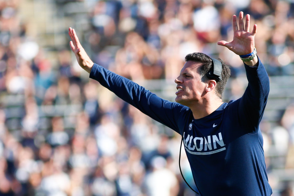 Head coach Bob Diaco yells from the sidelines during a 13-10 win over the Cavaliers on Saturday, Sept. 17 at Pratt and Whitney Stadium in East Hartford. (Photo by Tyler Benton/The Daily Campus)