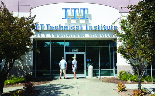 "Harold Poling, left, and Ted Weisenberger found the doors to the ITT Technical Institute campus closed after ITT Educational Services announced that the school had ceased operating, Tuesday, Sept. 6, 2016, in Rancho Cordova, Calif. The Carmel Ind., based company, which operates vocational schools, announced in a statement, Tuesday, that ""with profound regret"" it is ending academic operations at all of its more than 130 campuses across 38 states. Weisenberger was one quarter short of getting his degree in project management, and Poling was going to began taking classes in cybersecurity next week. (AP Photo/Rich Pedroncelli)"