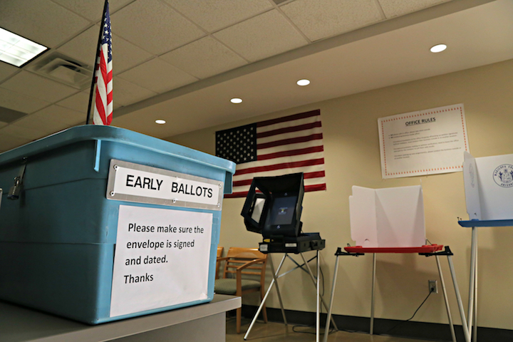 In this March 21, 2016 file photo, an example of an early ballot collection box and demonstration of voting areas is set up ahead of the state's Presidential Primary Election at the Maricopa County Recorder's office in Phoenix. (Ryan Van Velzer/AP)