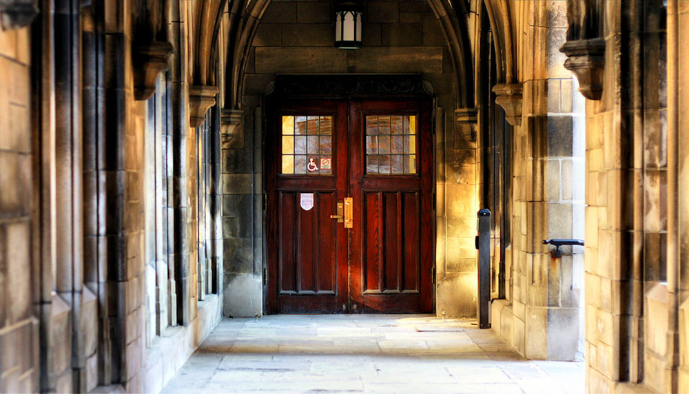 The University of Chicago, of which doors near the Bond Chapel are pictured above, was in the spotlight recently after the dean released a statement on trigger warnings and the university's policy against them. A new survey shows that half of U.S. professors use trigger warnings. (Phil Roeder/Creative Commons)