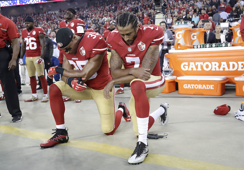 San Francisco 49ers safety Eric Reid (35) and quarterback Colin Kaepernick (7) kneel during the national anthem before an NFL football game against the Los Angeles Rams in Santa Clara, Calif., Monday, Sept. 12, 2016. (Marcio Jose Sanchez/AP Photo)