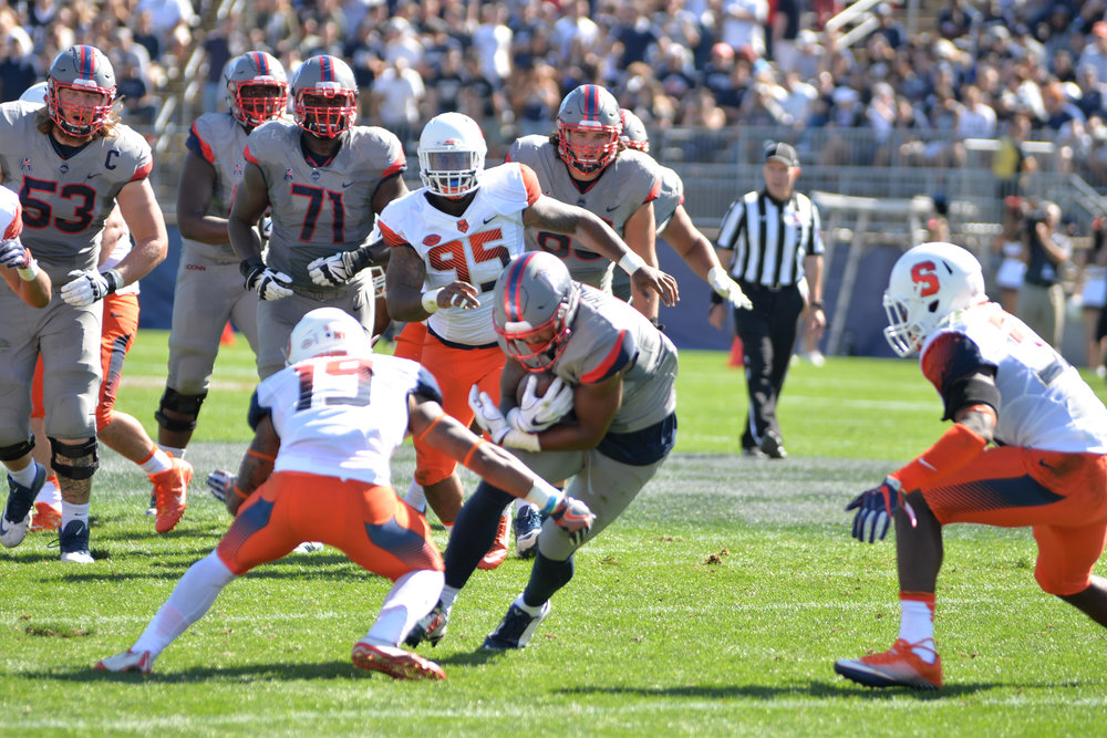 Noel Thomas carries the ball up the field during UConn's 31-24 loss to Syracuse on Saturday, Sept. 24, 2016. (Amar Batra/The Daily Campus)