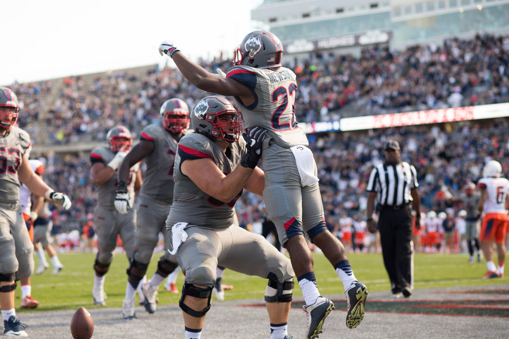 Running back Arkeel Newsome (22) celebrates his rushing touchdown in UConn's 31-24 loss to Syracuse on September 24, 2016 at Pratt & Whitney Stadium at Rentschler Field. (Jackson Haigis/The Daily Campus)