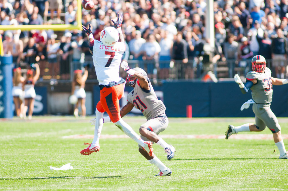 Syracuse University reciever Amba Etta-Tawo jumps for a pass during UConn's loss against Syracuse on Saturday, Sept. 24, 2016 at Rentschler Field. Etta-Tawo went head-to-head with UConn's own celebrated receiver, Noel Thomas. (Jackson Haigis)
