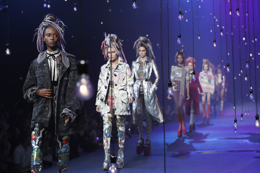 "In this Sept. 15, 2016, file photo, the Marc Jacobs Spring 2017 collection is modeled during Fashion Week in New York. Jacobs was criticized for showcasing white models in dreadlocks during the show. A screengrab showed Jacobs later responding on Instagram that he doesn't see color or race. In a separate post on Sunday, Sept. 18, 2016, Jacobs said he was sorry for ""the lack of sensitivity"" in responding to critics. (Mary Altaffer/AP Photo)"