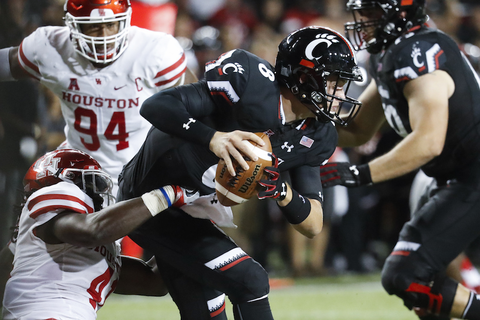 Houston linebacker Steven Taylor, left, sacks Cincinnati quarterback Hayden Moore during the second half of an NCAA college football game, Thursday, Sept. 15, 2016, in Cincinnati. Houston won 40-16. (John Minchillo/AP Photo)
