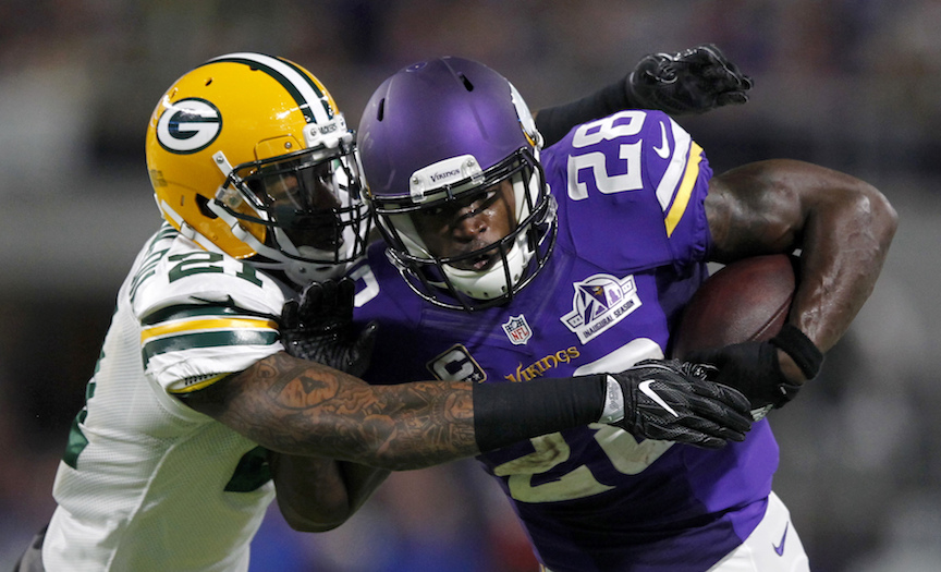 Minnesota Vikings running back Adrian Peterson (28) tries to break a tackle by Green Bay Packers free safety Ha Ha Clinton-Dix, left, during the first half of an NFL football game Sunday, Sept. 18, 2016, in Minneapolis. (Andy Clayton-King/AP Photo)