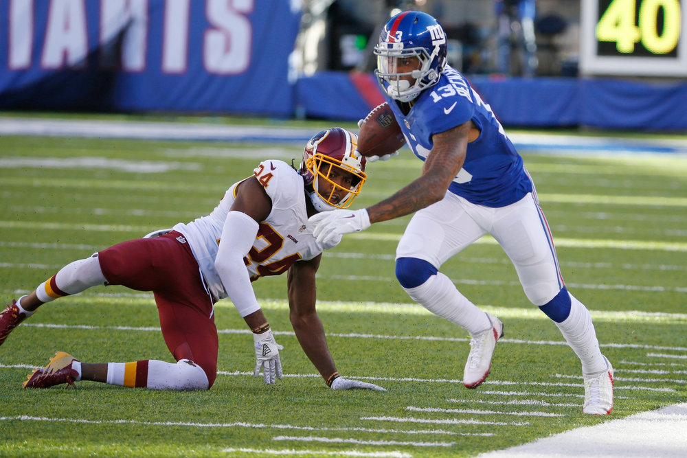 0b407aa72 New York Giants wide receiver Odell Beckham Jr. (13) runs away from  Washington