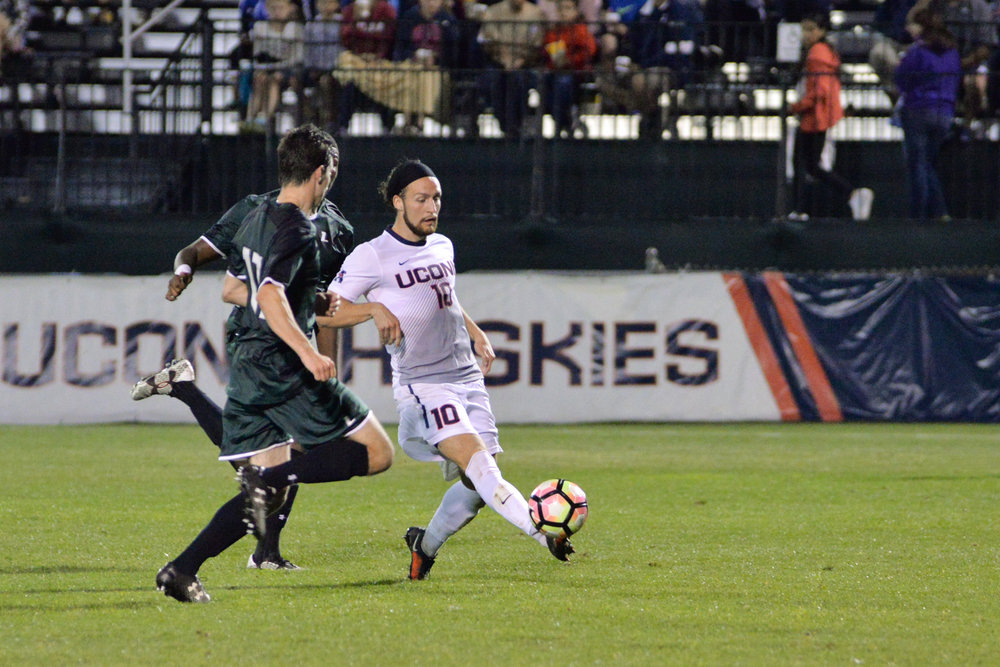 Sebastian Brems dribbles past defenders during UConn's 5-1 victory over Loyola on Saturday, Sept. 17, 2016 at Morrone Stadium. The Huskies look to continue their win streak on Wednesday as they travel to Providence to take on the Friars. (Amar Batra/The Daily Campus)