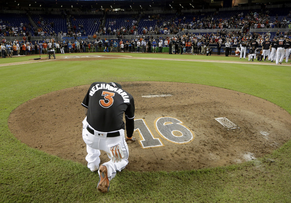 Miami Marlins' Adeiny Hechavarria (3) touches the pitcher's mound with the number 16 in honor of Marlins pitcher Jose Fernandez, after a baseball game against the New York Mets, Wednesday, Sept. 28, 2016, in Miami. (Lynne Sladky/AP Photo)