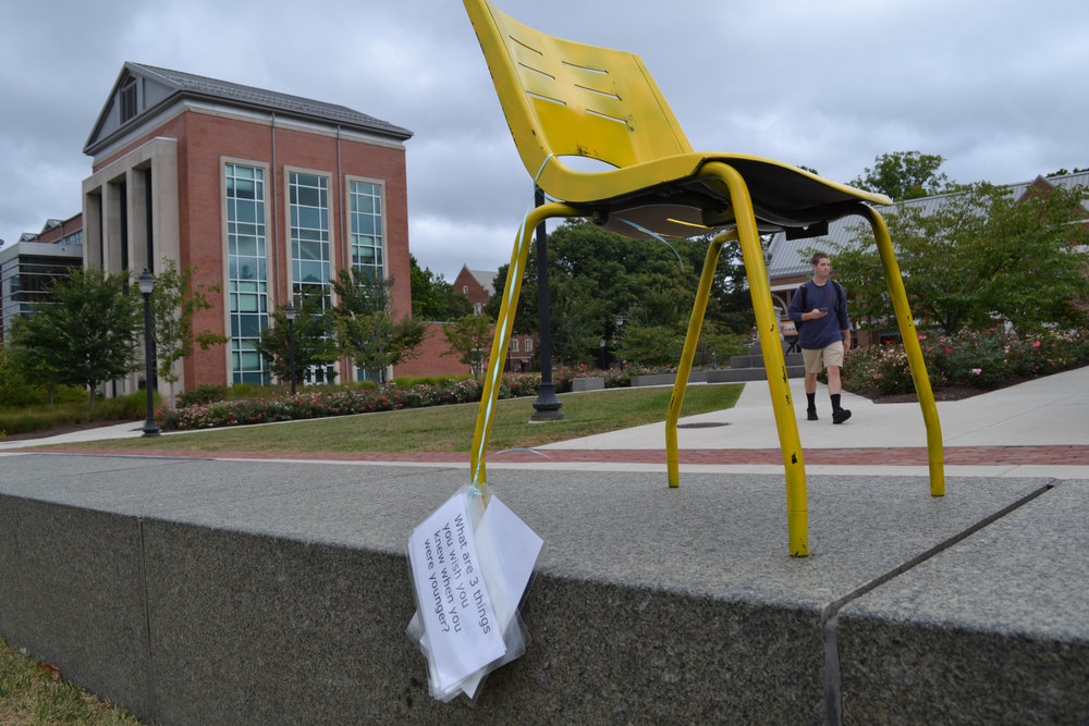 As a part of suicide prevention week, yellow chairs appeared in different parts of campus every day. There are reflective questions attached to the chairs to increase support and awareness for struggling students. (Olivia Stenger/The Daily Campus)