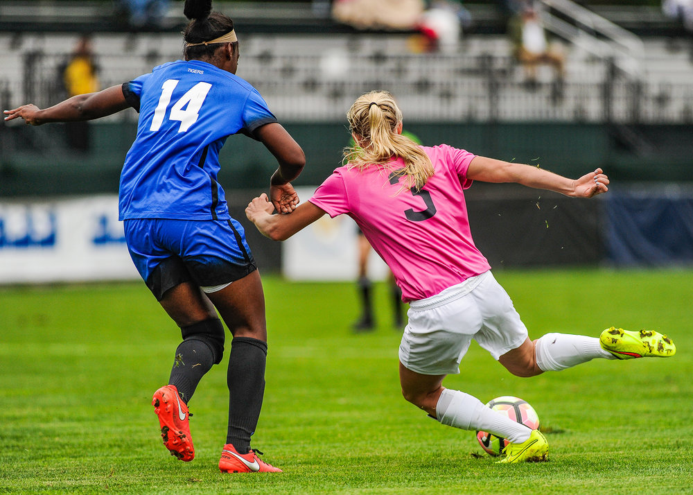 UConn forward Rachel Hill winds up to kick the ball past a Memphis opponent at Joseph J. Morrone Stadium on Sunday Oct. 2, 2016. The Huskies won 4-1. (Jason Jiang/The Daily Campus)