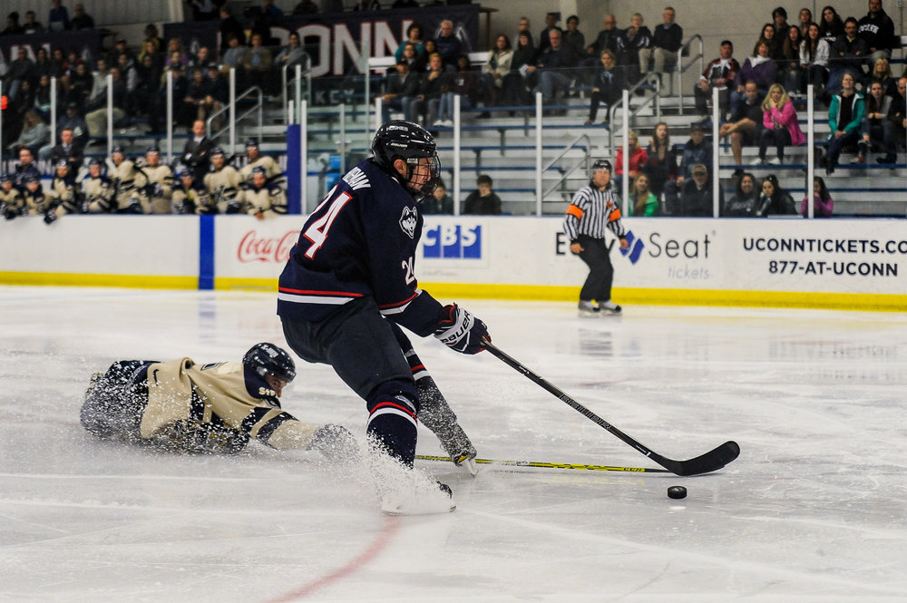 Freshman forward Benjamin Freeman avoids a fallen St. Francis player during the Huskies 4-3 loss to St. Francis-Xavier. (Jason Jiang/The Daily Campus)