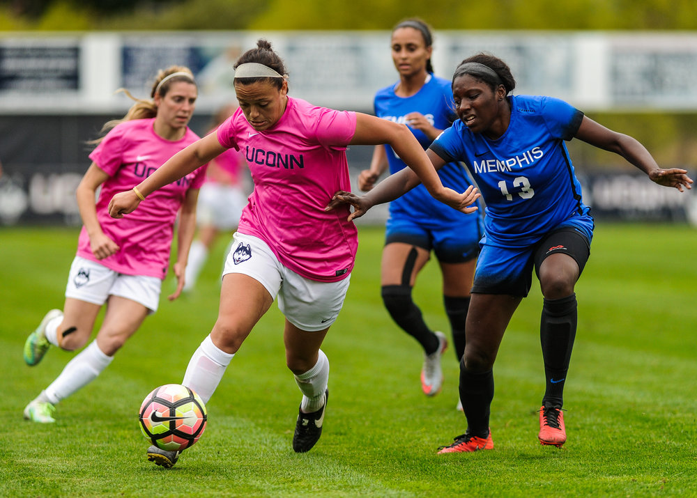 Senior forward Stephanie Ribeiro races past a Memphis defender during the Huskies 4-1 victory on Sunday, Oct. 2, 2016. Ribeiro scored two goals and is now tied for most goals in the country. (Jason Jiang/The Daily Campus)
