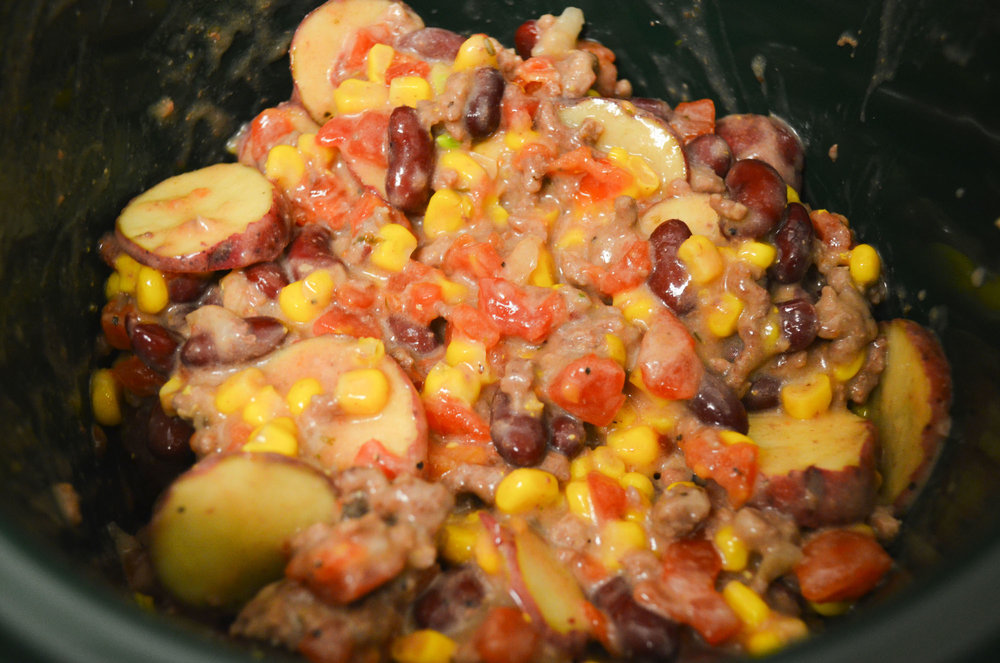 Mixing the ingredients of Cheesy Crockpot Chili. (Claire Galvin/The Daily Campus)