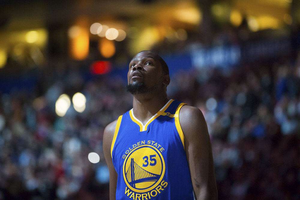 Golden State Warriors'Kevin Durant looks on before a preseason NBA basketball game against the Toronto Raptors, in Vancouver, British Columbia, Saturday Oct. 1, 2016. (Darryl Dyck/The Canadian Press via AP)