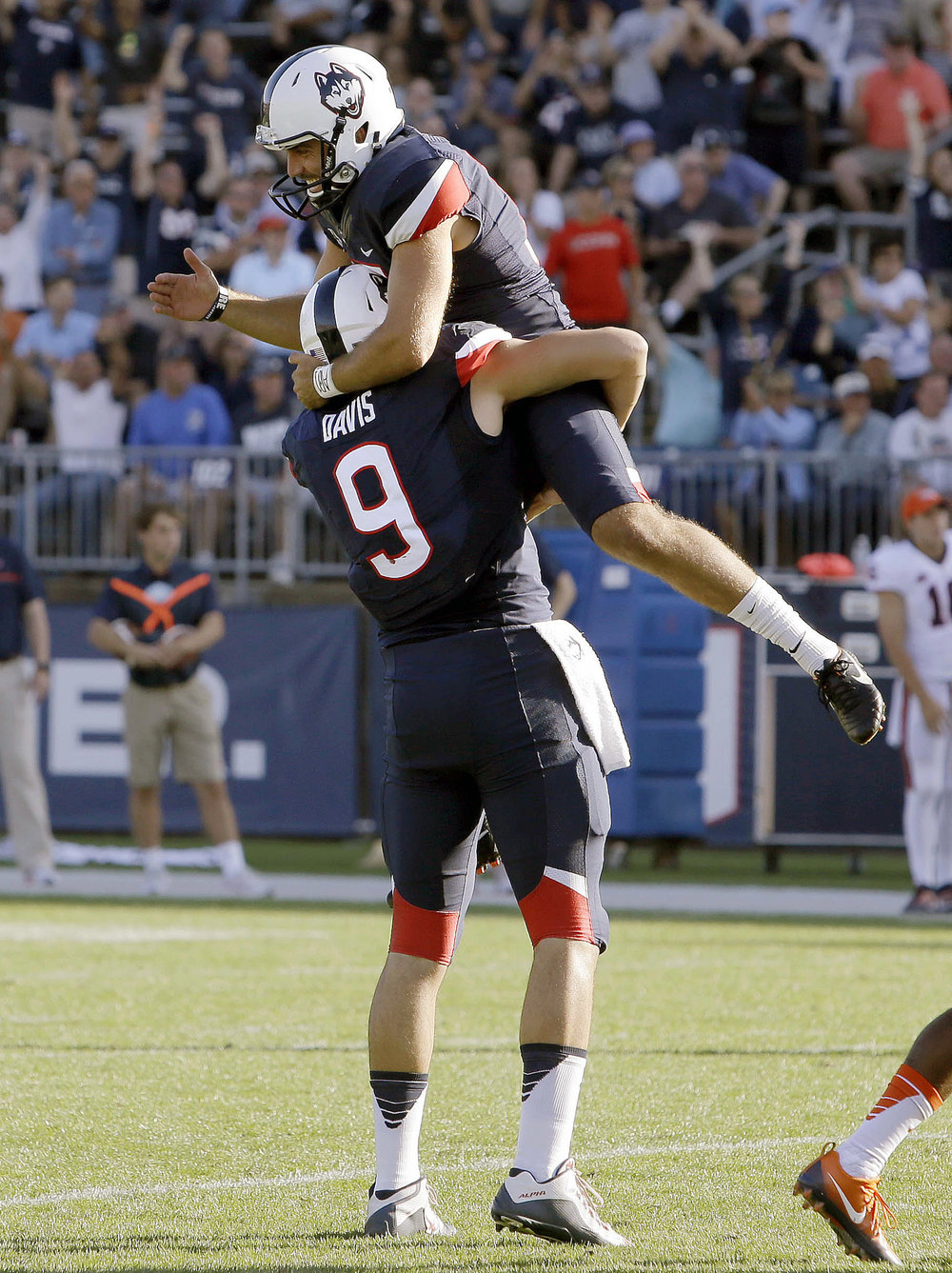 Connecticut placekicker Bobby Puyol, top, celebrates his game-winning field goal with Tyler Davis (9) in the second half of an NCAA college football game against Virginia, Saturday, Sept. 17, 2016, in East Hartford, Conn. Connecticut won 13-10. (Bill Sikes/AP)