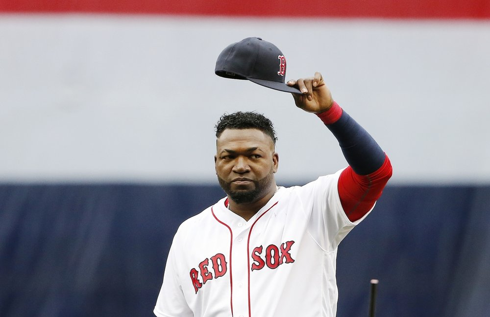 Boston Red Sox's David Ortiz tips his cap to the crowd during ceremonies before a baseball game against the Toronto Blue Jays in Boston, Sunday, Oct. 2, 2016. (Michael Dwyer/AP)