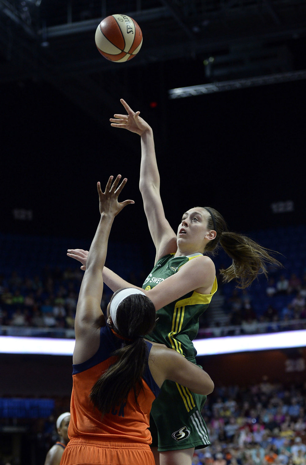 Seattle Storm's Breanna Stewart shoots over Connecticut Sun's Morgan Tuck during the second half of a WNBA basketball game in Uncasville, Conn. Both are UConn grads and Stewart is the newest WNBA rookie of the year. (Jessica Hill, File/AP)