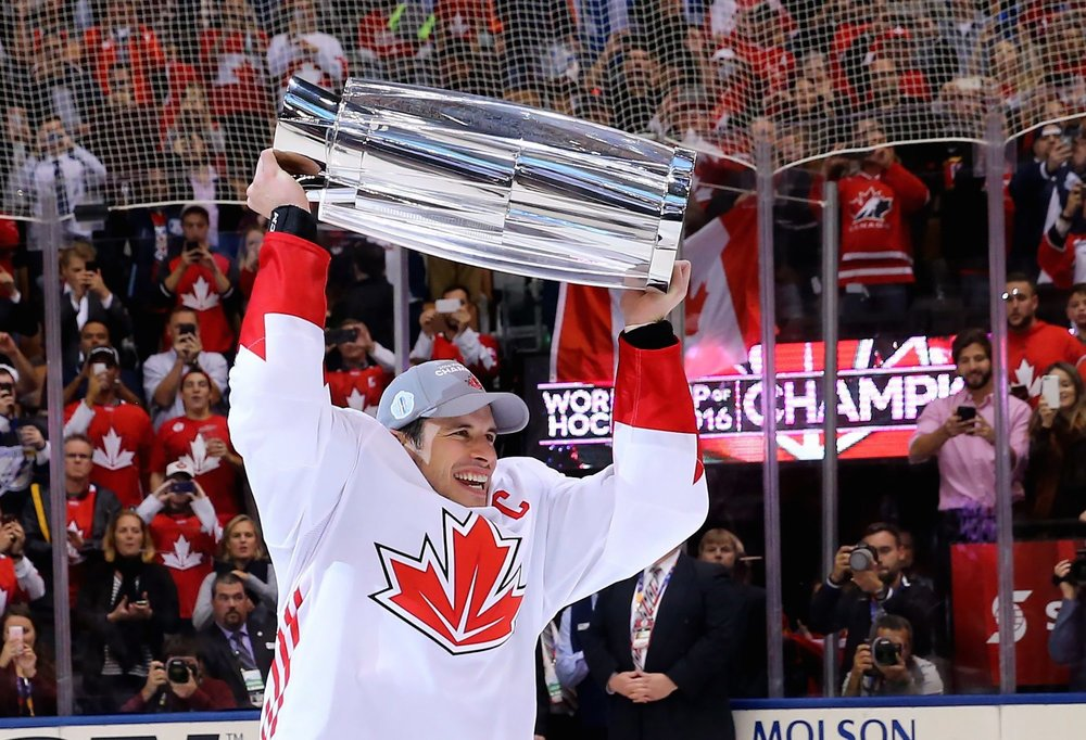 d1753e49d71 Canada s Sidney Crosby hoists the trophy following his team s victory over  Europe in the World Cup