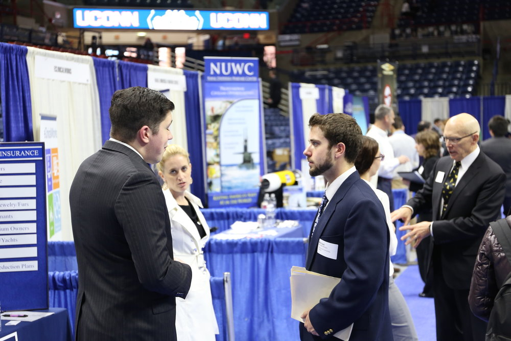 Students navigate UConn's spring career fair, put on by the Center for Career Development in Gampel Pavilion on March 30, 2016. Dozens of employers sent representatives to speak with students about full-time opportunities, internships, and more. (Jackson Haigis /The Daily Campus)