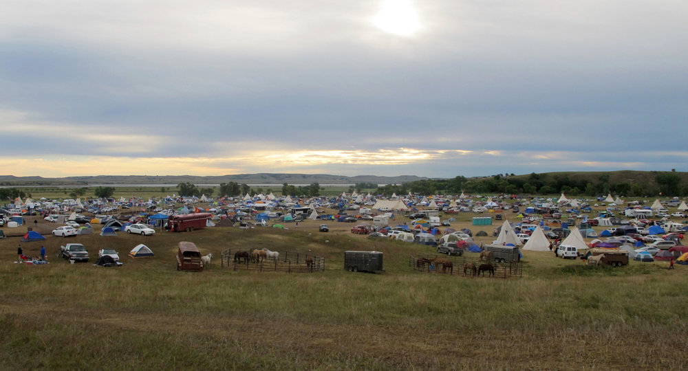 In this Sept. 9, 2016 file photo, More than a thousand people gather at an encampment near North Dakota's Standing Rock Sioux reservation. (James MacPherson/AP)