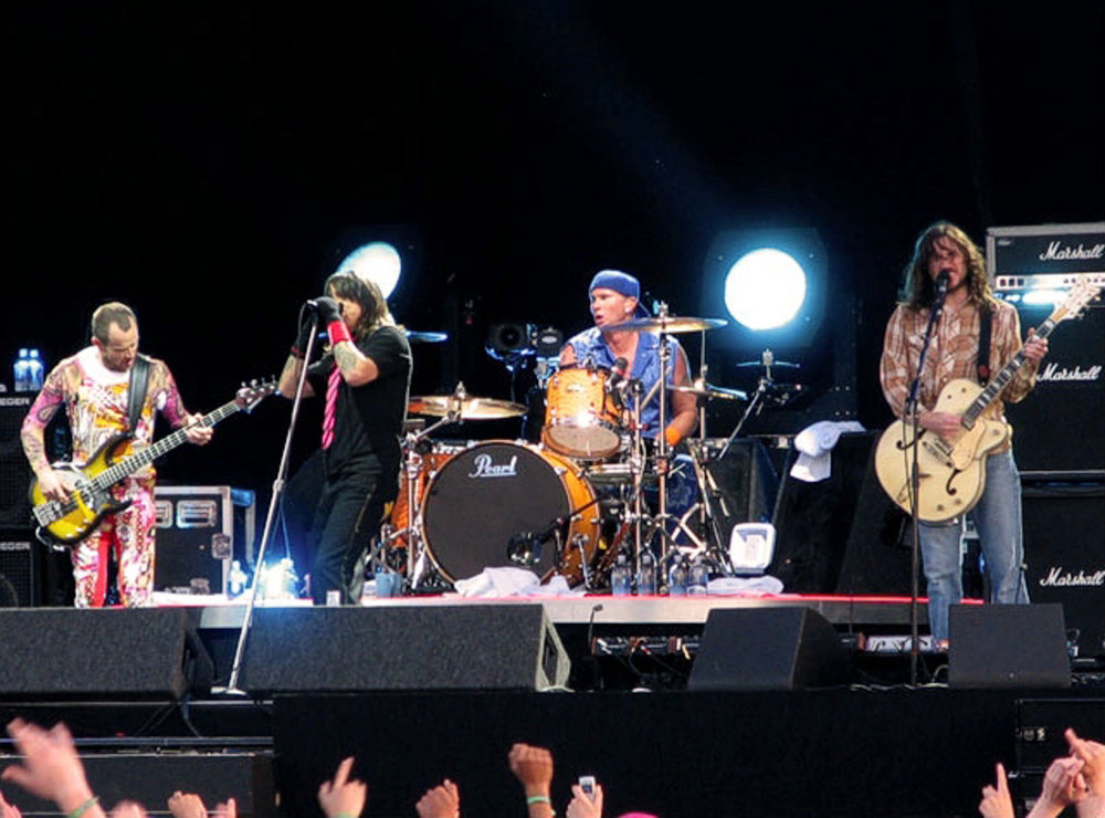 The Red Hot Chili Pepppers peform during the Stadium Arcadium World Tour featuring its long-time lineup: Flea, Kiedis, Smith, Frusciante, in 2006 (xPassenger/Flickr Creative Commons)