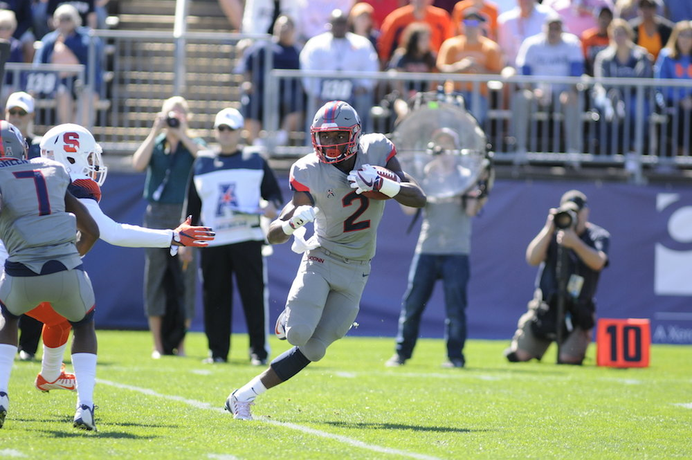 Arkeel Newsmen (#2) breaks off a run in a game against Syracuse on Saturday, Sept. 24 in which the Huskies lost 31-24. The Huskies will play Cincinnati on Saturday, Oct. 8, 2016 at Rentschler Field in East Hartford. (Jackson Haigis/The Daily Campus)