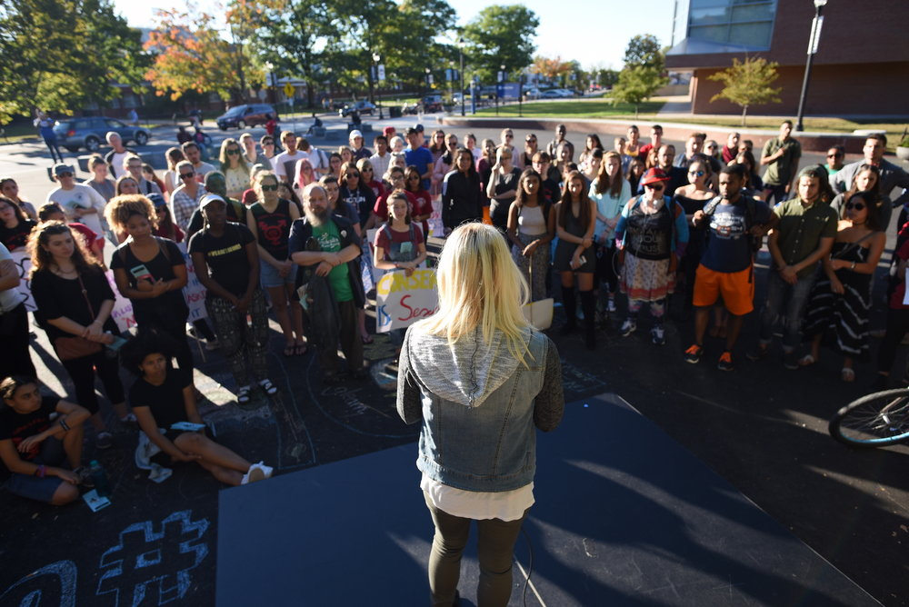 A student speaks to the crowd during the speakout session after the UConn Slutwalk march on Friday, Oct. 7, 2016. The speakout session is a part of the SlutWalk when anyone can take a microphone and share their experiences related to sexual assault. (Zhelun Lang/The Daily Campus)