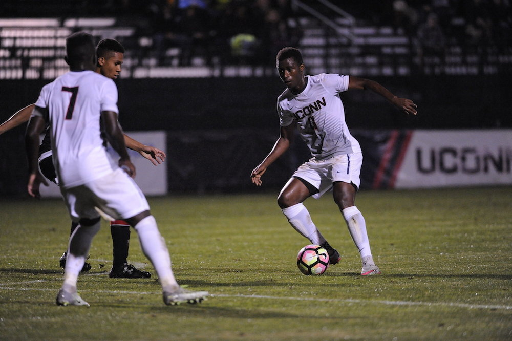 Abdou Mbacke Thiam (#11) passes the ball to Kwame Awuah (#7) in the midst of a Cincinnati defender in a game on Saturday Oct. 8, 2016 at Joesph J. Morrone Stadium. The Huskies won 5-0. (Jason Jiang/The Daily Campus)