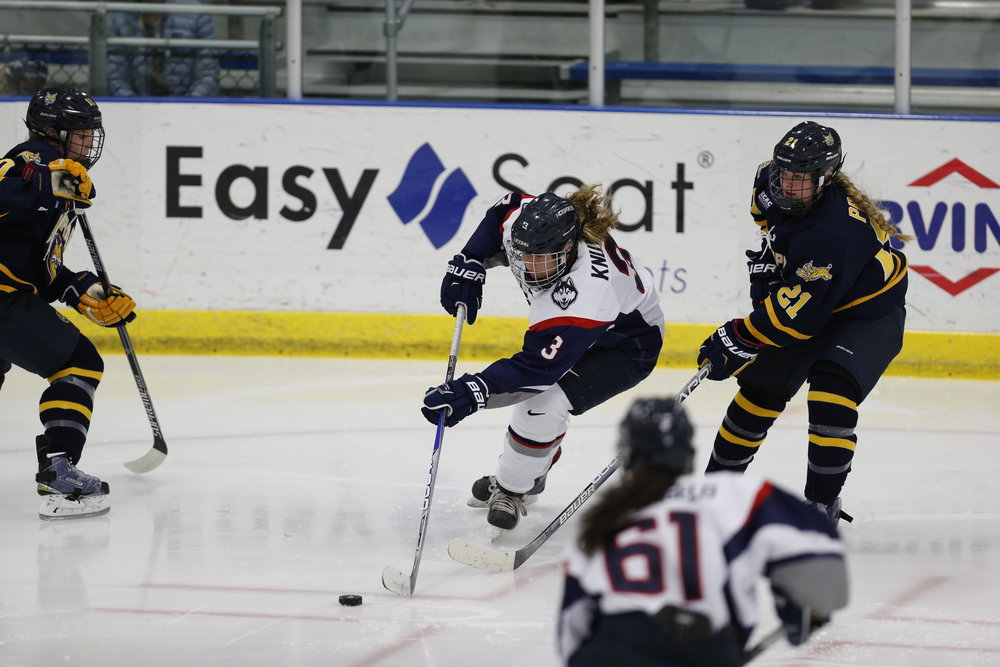 Theresa Knutson (#3) handles the puck as Briana Colangelo (#61) looks on. The Huskies lost to QU 3-0 on Saturday Oct. 8, 2016. (Tyler Benton/The Daily Campus)