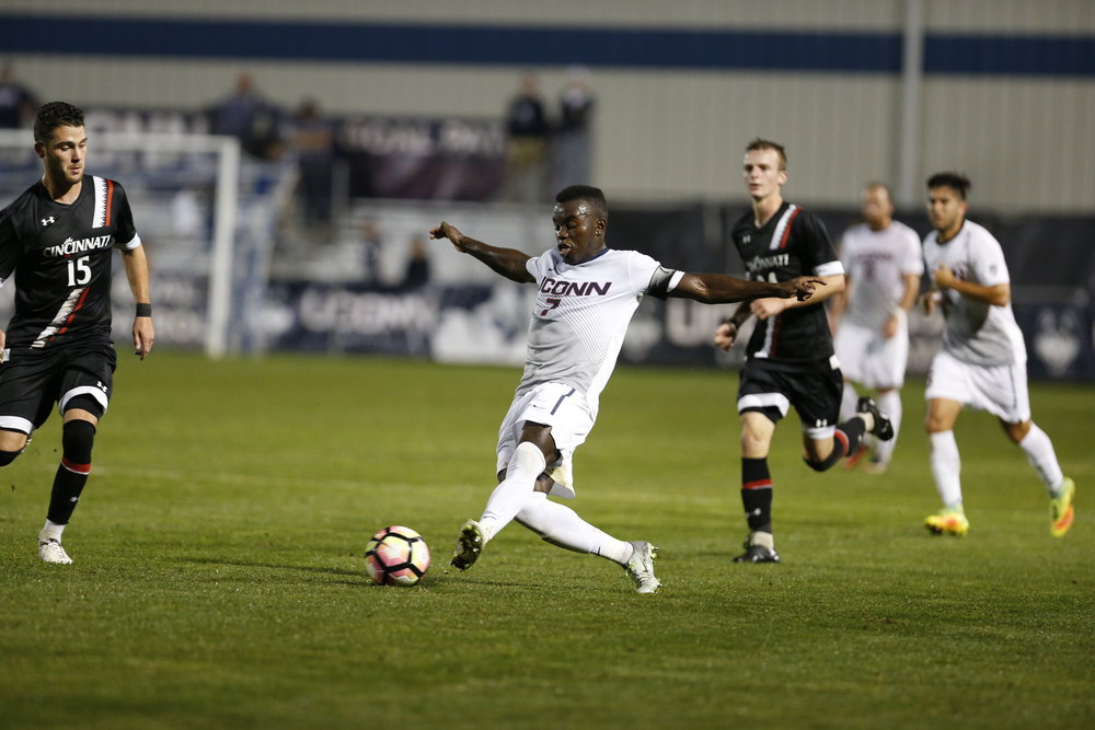 Kwame Awuah (#7) plays the ball in the Huskies 5-0 win over Cincinnati on Saturday Oct. 8, 2016 at Joseph J. Morrone Stadium. Awuah, Abdou Mbacke Thiam, Sebastian Brems, and Simen Olafsen scored. (Tyler Benton/The Daily Campus)
